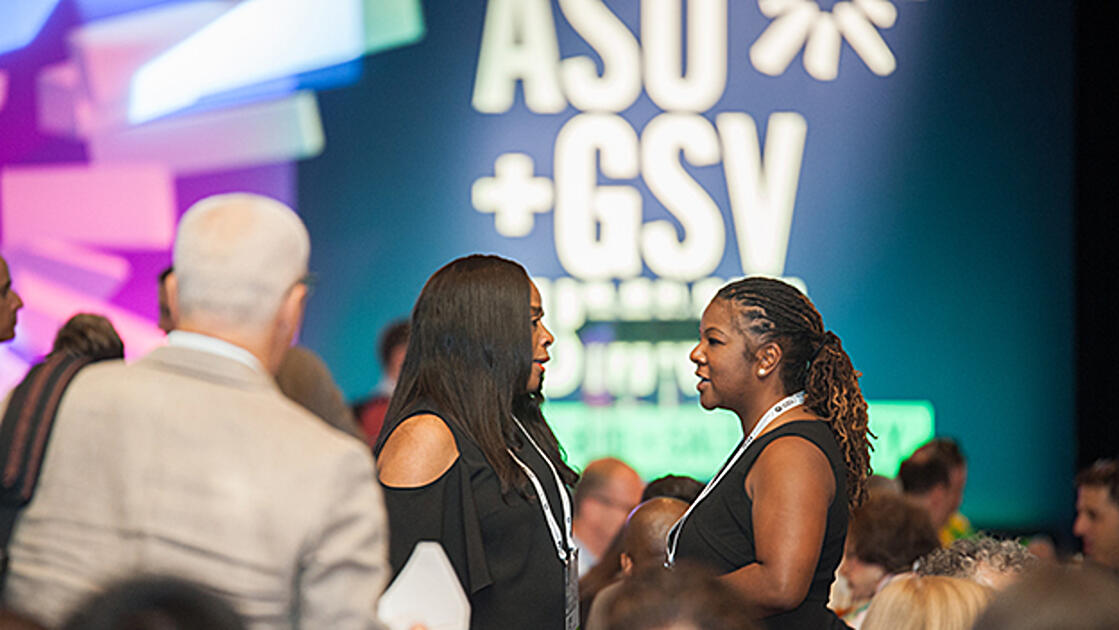 Attendees meeting at the summit.